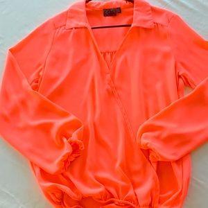 Neon orange stylish dressy blouse.